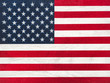 American Flag lying on the table. Place for your inscriptions. Top view, close-up. National holiday concept