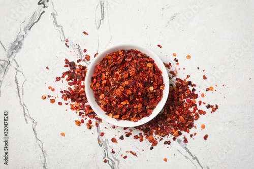 Fototapeta Bright red cayenne pepper spice for tasty cooking obraz