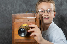 Cheerful Boy Retro Photographer With Vintage Wooden Camera
