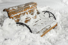 Wooden Bench In Deep Snow