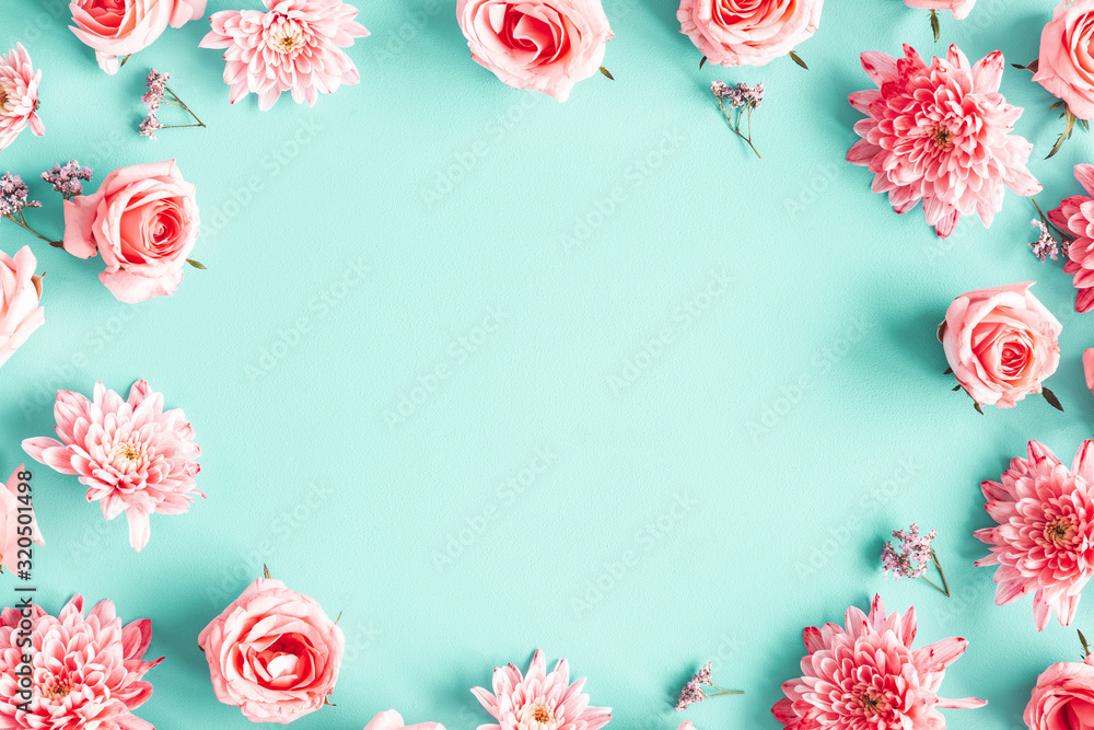 Fototapeta Flowers composition. Rose flowers on blue background. Valentines day, mothers day, womens day concept. Flat lay, top view, copy space