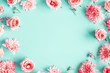 Leinwandbild Motiv Flowers composition. Rose flowers on blue background. Valentines day, mothers day, womens day concept. Flat lay, top view, copy space