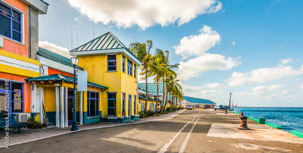 Fototapeta Colorful houses at the cruise terminal and port of Nassau, Bahamas.