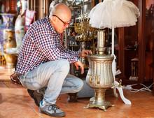 Man Choosing Ancient Things In...