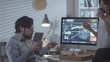 Tracking shot of bearded businessman and Asian businesswoman eating pizza and drinking coffee while taking break from work in dark office