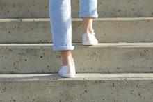 Woman Legs Wearing Sneakers Wa...