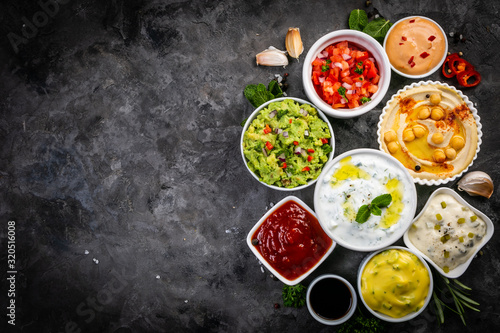 Fototapeta Selection of sauces in white bowls on white bowls, top view obraz
