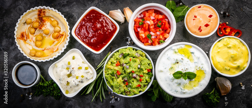 Selection of sauces in white bowls on white bowls, top view Canvas Print