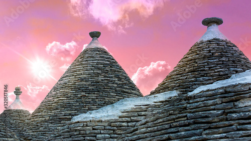 Panoramic view of ancient traditional  buildings called Trulli in Alberobello Canvas Print