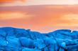 Leinwanddruck Bild - Detail of the blue glacial ice of Svinafellsjokul glacier at sunset