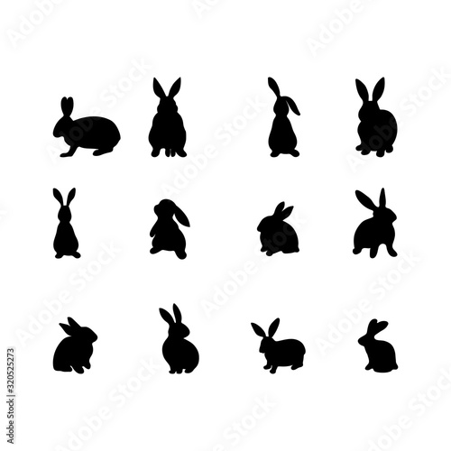 A set of rabbits silhouette in different shapes and actions isolated on a white background Wallpaper Mural