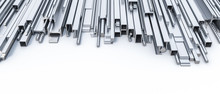 Metal Profiles Of Different Shapes And Sizes On A White Background
