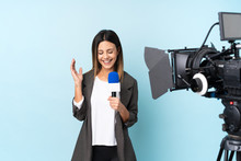 Reporter Woman Holding A Micro...