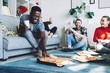 canvas print picture - Multiracial friends eating pizza at home
