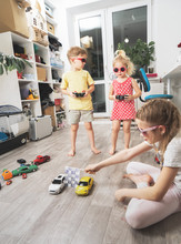 Children's Hobbies: Children Play At Home With Radio-controlled Models Of Cars And Organized Racing Competitions.
