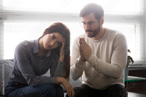 Husband apologizes to his wife begs forgiveness feels guilty Wallpaper Mural