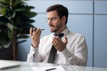 Businessman Holding Smartphone Speaking Through Microphone Sending Voice Message