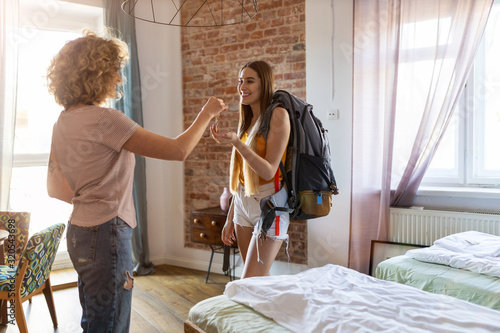 Young female backpacker renting apartment Canvas Print