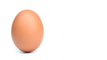 Single Brown Eggs Isolated From White Background With Copy Space For Writing Text.