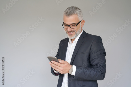 Fototapety, obrazy: Businessman using smartphone, isolated