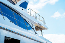 Nautical Background Of Luxury Yachts, With Black Tinted Windows And Chrome Metal Railings On White Fiber Glass Bows