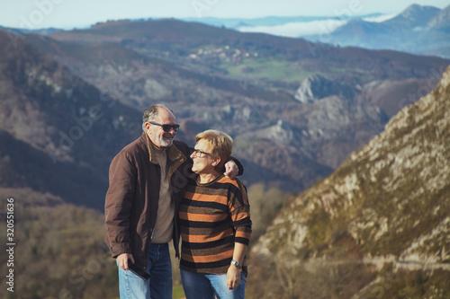 pareja de jubilados disfrutando de un día en las montañas de asturias Canvas Print