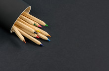 Colored Wooden Pencils On A Bl...