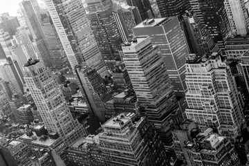 Aerial view of New York skyline with Manhattan midtown urban skyscrapers, New York City, USA. Black and white image.
