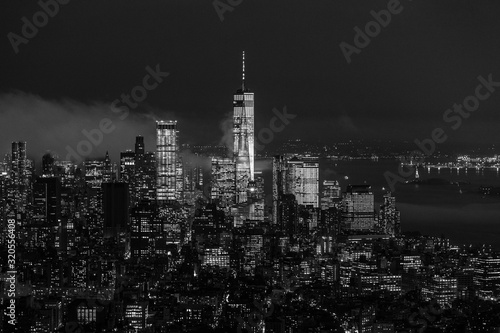 Fototapeta New York City skyline with lower Manhattan skyscrapers in storm at night. Black and white image. obraz