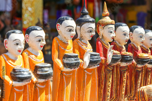 Photo Figurines of monks collecting donations in the ancient souvenir market in Myanma