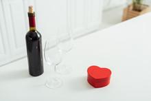 Red Heart-shaped Gift Box Near...