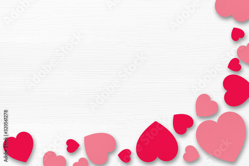 Fototapeta Red paper hearts on white wooden background. Valentines Day concept. obraz