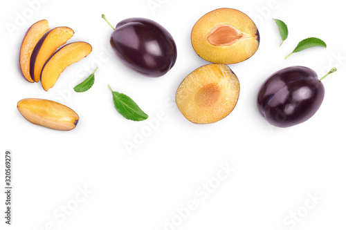 Photo fresh purple plum and half with leaves isolated on white background with clipping path and copy spase for your text
