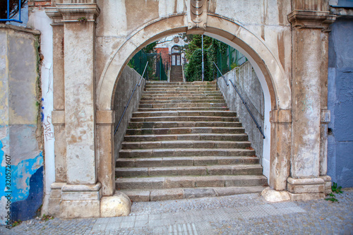 medieval architectural entrance with arch and stairs