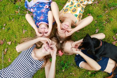 Fototapeta Children lying together enjoying summer holidays obraz