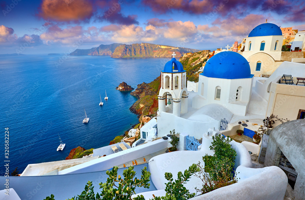 Fototapeta Fira town on Santorini island, Greece. Incredibly romantic sunrise on Santorini. Oia village in the morning light. Amazing sunset view with white houses. Island of lovers
