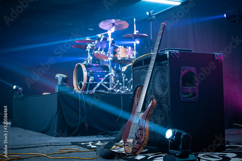 Guitar amplifier and drum kit on a stage Canvas Print