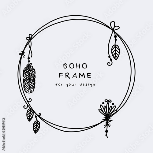 Photo Beautiful boho frame with hanging feathers and leaves vector