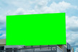 Leinwanddruck Bild - billboard blank and blue sky, copy space on green screen