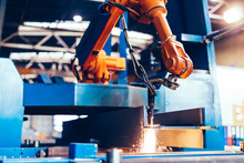 Robotic Arm In A Factory At Wo...