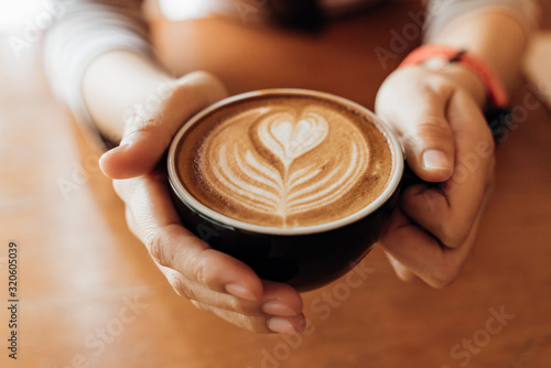 Close up Cup of coffee latte in coffee shop Fototapeta