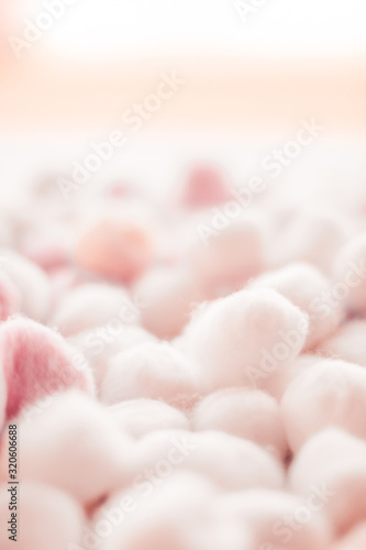 Organic cotton balls background for morning routine, spa cosmetics, hygiene and Wallpaper Mural