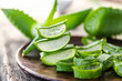 Leinwanddruck Bild - Slices of aloe vera in a bowl on a wooden table.