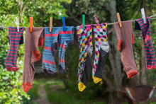 Colorful Socks Hanging On Wash...