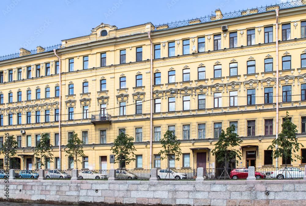 Fototapeta Buildings on waterfront of St. Petersburg summer day, Russia