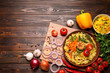 canvas print picture - Flat lay composition with tasty rice pilaf on wooden table. Space for text
