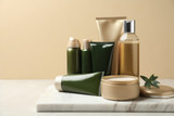 Fototapeta Kawa jest smaczna - Different cosmetic products on white table against beige background