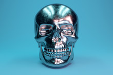 A Scratched Metal Human Skull Glamorous Blue Background. 3d Illustration
