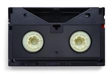 VHS Videotapes On A White Back...