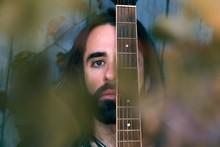 Bearded Guitarist With Long Ha...